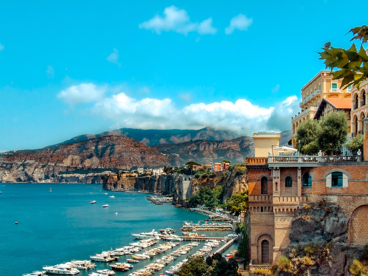 Italian Coastline with bright blue sky and Italian village