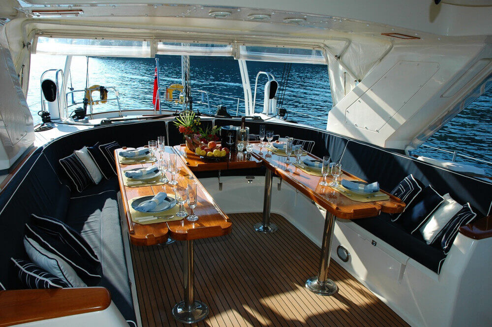 Saloon of large yacht ready for dinner