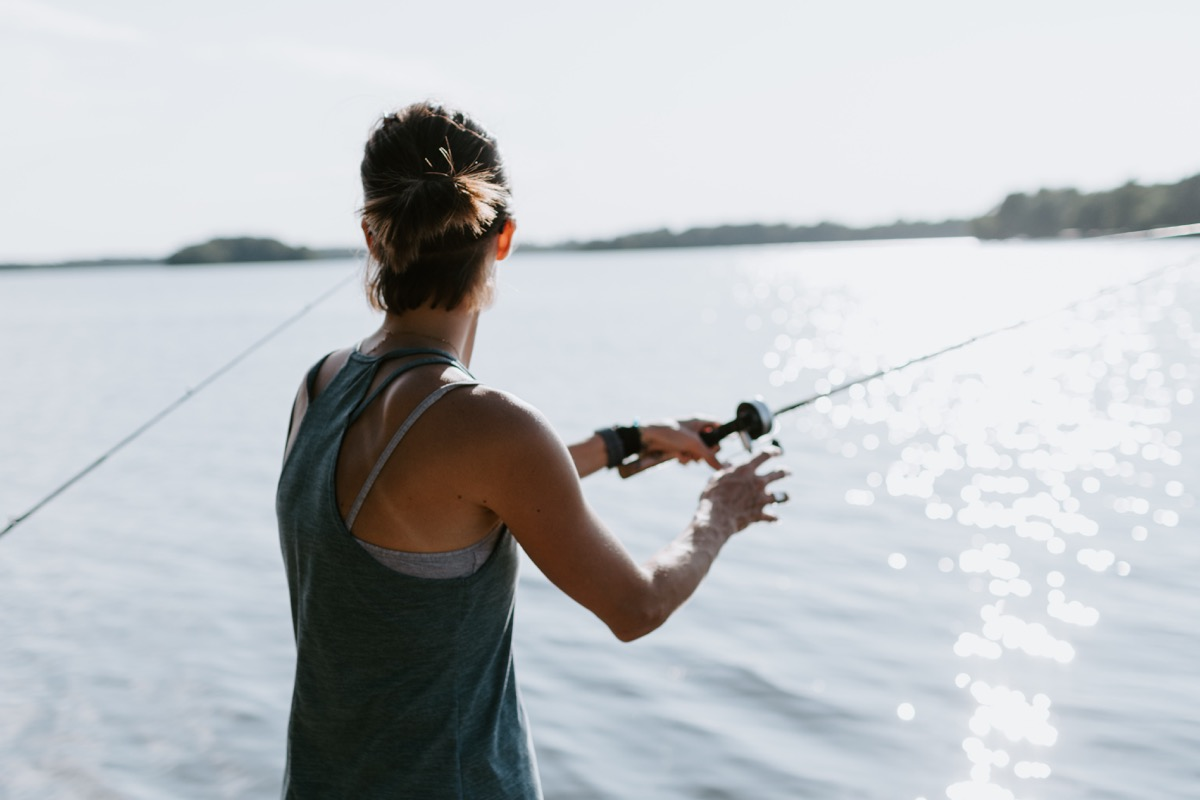 Woman fishing with fishing rod
