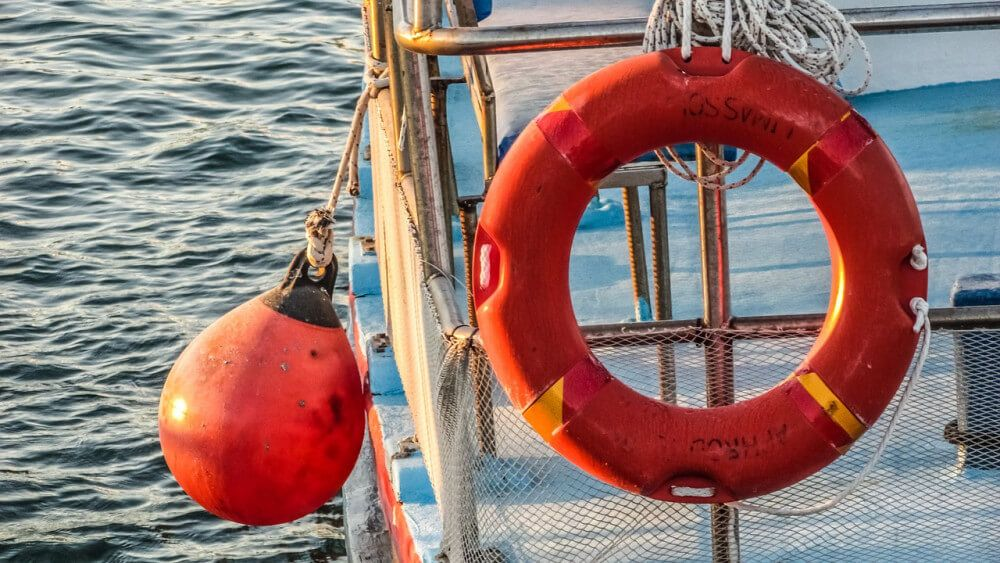 PFD and buoy on board of boat