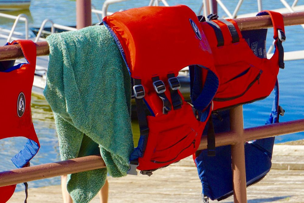 Sailing safety gear hanging from rail on boat