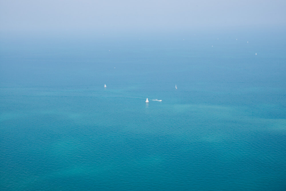 Number of sailboats from birdseye perspective doing offshore sailing