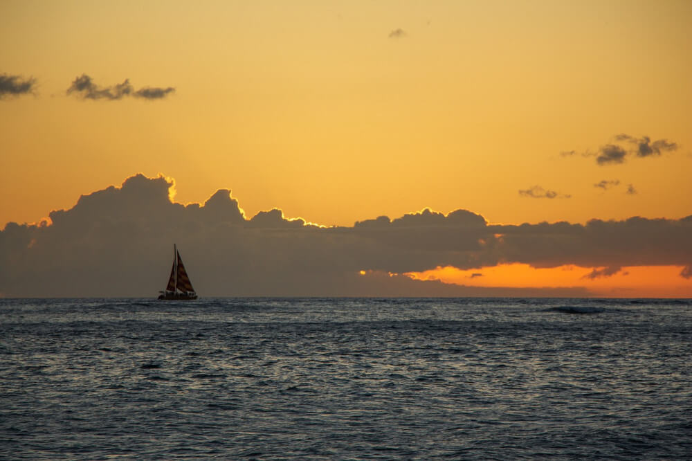 Sailboat at dusk in open water