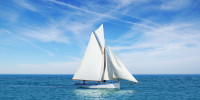 Beautiful white gaff-rigged cutter with gaff top sail and two staysails