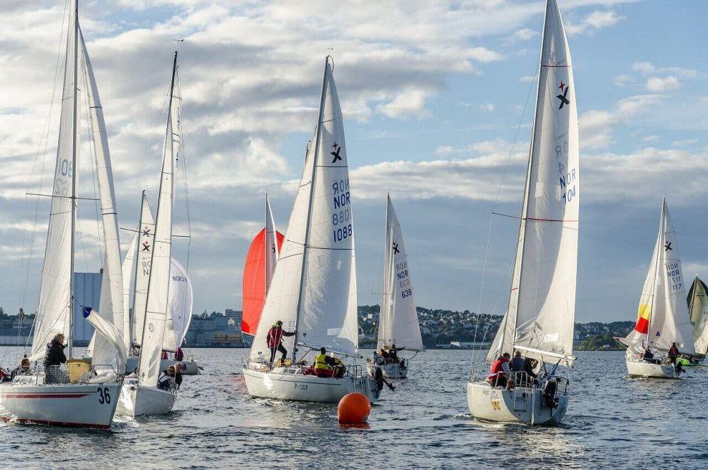Sailing regatta with dozen sailboats in race