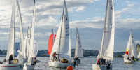 Sailing regatta with dozen sailboats in race