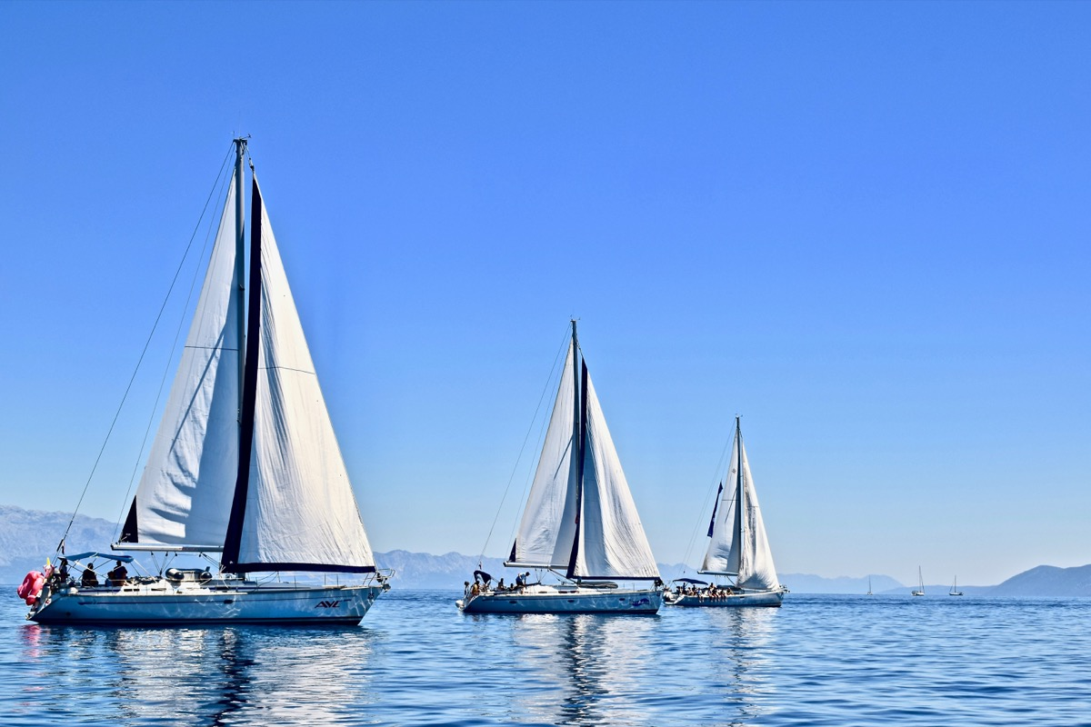 Three Bermuda Sloops in bright blue water