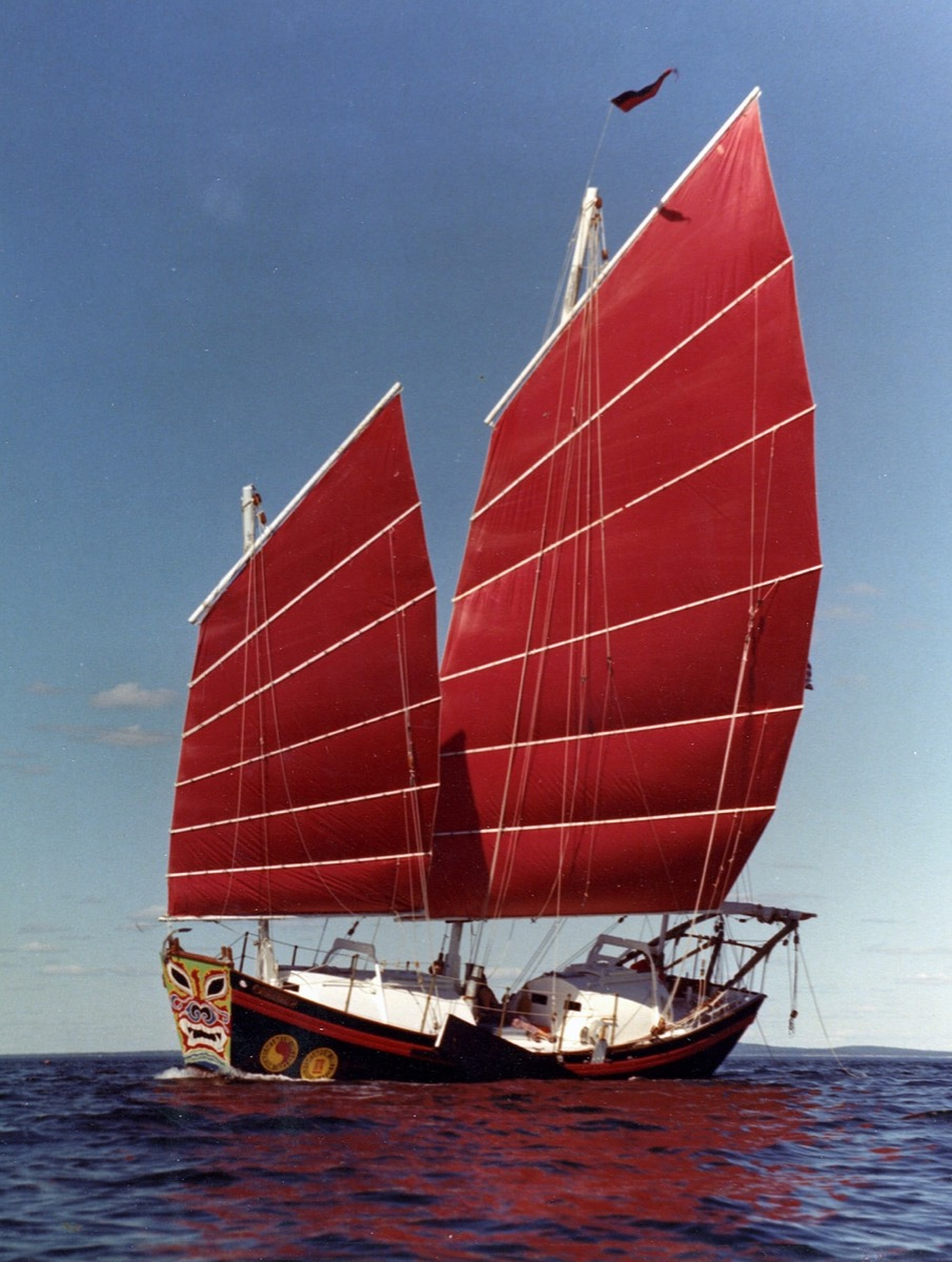 Chinese Junk sailboat with red sails