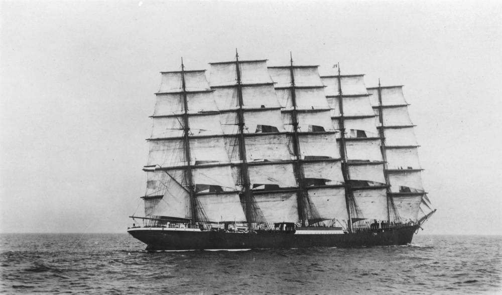 Black and white image of five masted tall ship