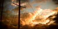 Sunset with clouds and mast