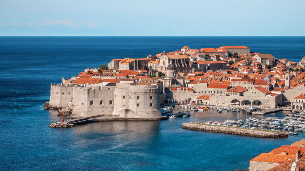 The old stone city walls of Dubrovnik, which are in the water